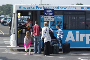 Family getting on the Airparks bus