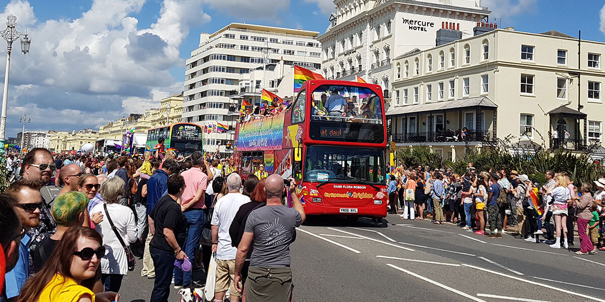 Crowd by the seaside at the Brighton Pride parade